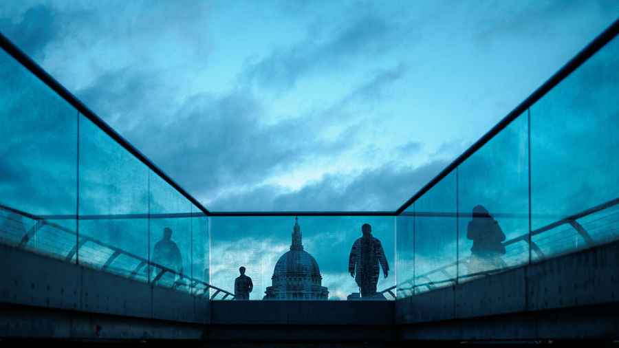 Low angle view of silhouette people on london millennium footbridge