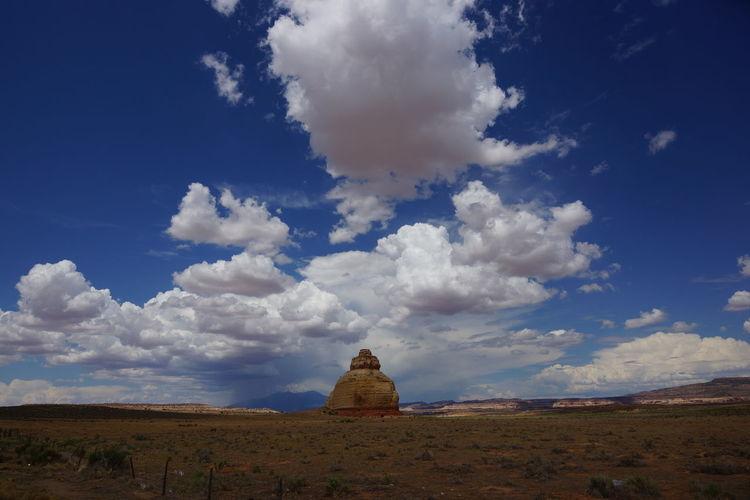 Rock formation at desert against sky