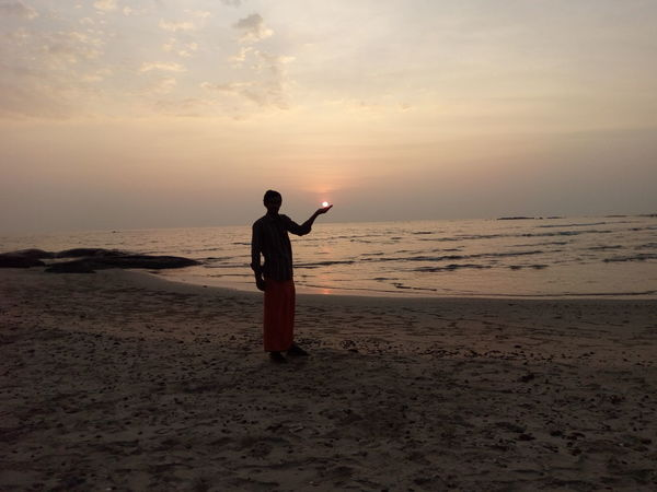 Beach One Person Sand Anticipation Full Length Outdoors Desert Beauty In Nature Nature Sky Day Sunbeam Beauty In Nature Water My Year My View Sunlight Sun Only Men Sea Sunsetlover Sunset_captures Sunset Lovers