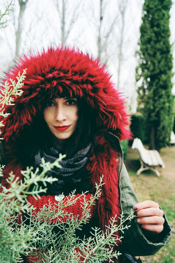One Person Real People Young Adult Young Women Clothing Lifestyles Front View Red Leisure Activity Women Winter Warm Clothing Adult Day Beautiful Woman Portrait Focus On Foreground Looking At Camera Outdoors Hairstyle Hood - Clothing
