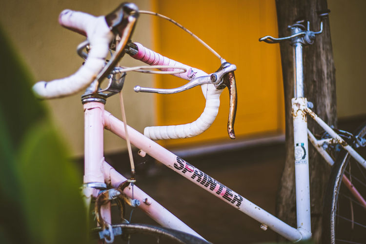 Close-up of bicycle parked on metal chain