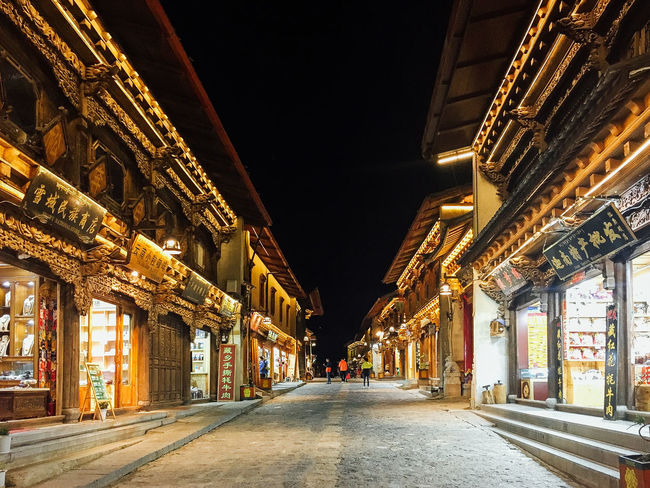 Shangri-La Architectural Column Architecture Building Building Exterior Built Structure China City Diminishing Perspective Direction Illuminated Incidental People Night Outdoors Road Street The Way Forward Travel Destinations Yunnan