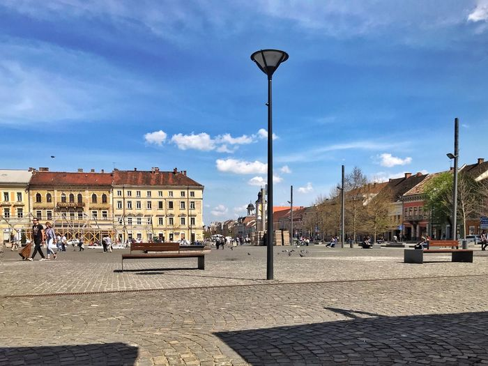 Downtown Cluj Napoca Architecture Building Building Exterior Built Structure City Cloud - Sky Cobblestone Crowd Day Group Of People Lighting Equipment Nature Outdoors Real People Sky Street Street Light Sunlight Town Women