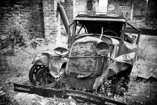 Vintage cars in Oradour sur plane, France. Blackandwhite Damaged Deterioration Old Oradour Sur Glane Outdoors Run-down Vintage Cars Wrecks