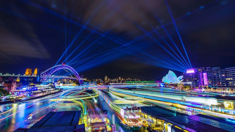 VIVID Ferries Vivid Sydney Illuminated Night Built Structure Architecture Lighting Equipment Building Exterior Motion City Sky Nature Long Exposure Travel Destinations Glowing City Life No People Water Blue Building Modern Nightlife