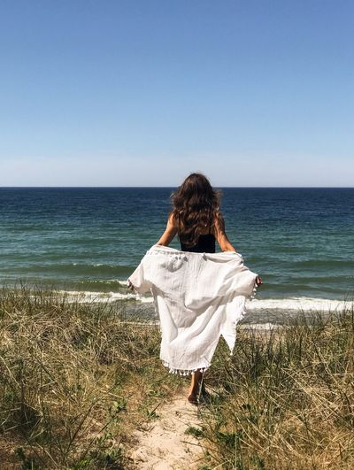 Sea Rear View Horizon Over Water Beach One Person Water Tranquility Tranquil Scene Women Clear Sky Real People Getting Away From It All Leisure Activity Standing Outdoors Vacations Scenics Beauty In Nature Curonian Spit Kaliningrad Vacations Summer Live For The Story