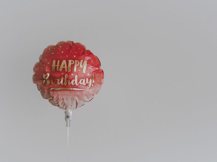 Pink Happy Birthday balloon Studio Shot Copy Space Text Western Script White Background Sweet Food No People Freshness Communication Close-up Single Object Balloon Happy Birthday!