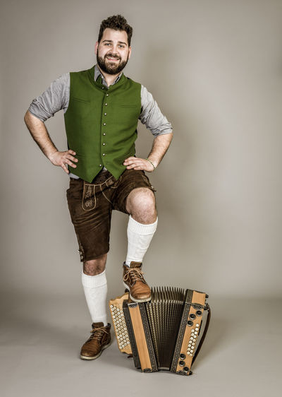 Musician Costume Leather Trousers Tradition Traditional Austria Green Pose Accordion Man Young Shorts Friendly Proud Happy Play Music Fun Joy Single One Background Copy Space Studio Entertainment Mountains Shirt STAND Hobby Leisure Cool One Person Full Length Indoors  Front View Studio Shot Young Men Young Adult Standing Portrait Casual Clothing Looking At Camera Emotion Holding Smiling Beard Adult Gesturing White Background Making A Face