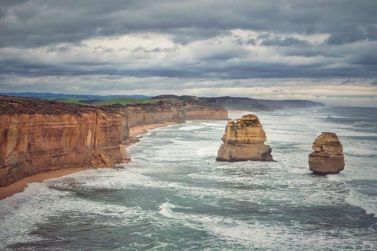 Rock formations by sea at twelve apostles sea rocks