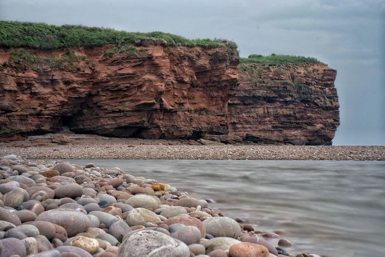 Budleigh Rock, pebbles and sea Seascape Rock Formation Jurassic Coast Devon Estuary Beauty In Nature Water Sea Rocky Coastline Eroded Pebble Scenics - Nature Tranquil Scene Coast Red Rocks  Tranquility No People Beach Outdoors Non-urban Scene Rock - Object Land Nature Day