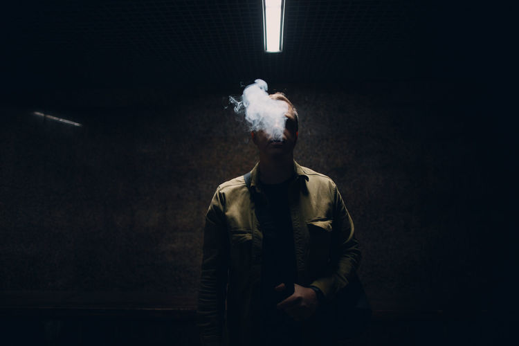 Digital composite image of man smoking cigarette