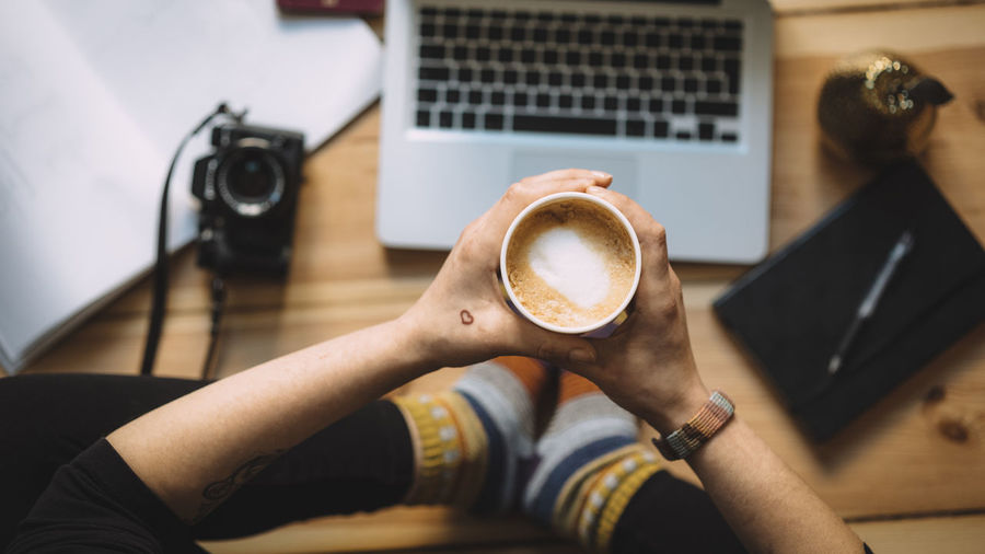 Productivity Berlinstagram Camera Cappuccino Coffee - Drink Coffee Cup Cup Heart Holding Human Hand Indoors  Laptop One Person Productivity Real People Tattoo Technology Top View View From Above Woman Working Fresh On Market 2017 Market Bestsellers 2017 Modern Workplace Culture