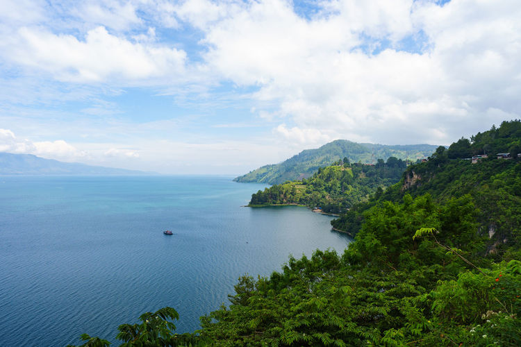 Lake Toba of Sumatra - Indonesia Danau Danau Toba INDONESIA Lake Toba Nature Toba Beauty In Nature Cloud - Sky Day Horizon Over Water Island Lake Landscape Nature Outdoors Parapat Samosir Scenics Simalungun Sky Tapanuli Tranquil Scene Tranquility Vulcanic Water