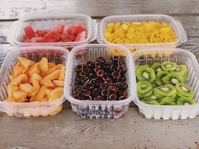 High angle view of fruits in containers on table