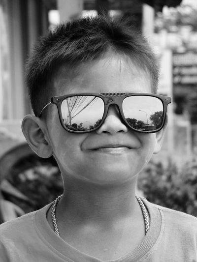 Close-Up Portrait Of Boy Wearing Sunglasses