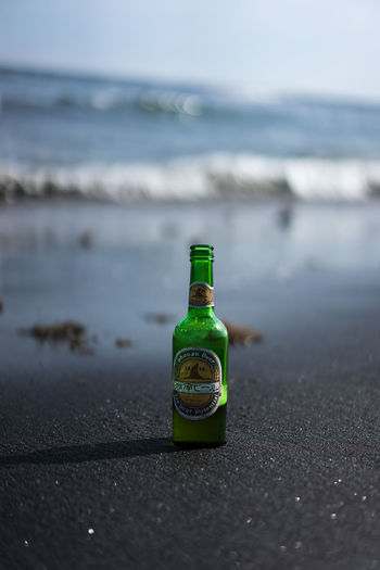 Alcohol Beach Beer Bottle Bottle Container Day Drink Focus On Foreground Green Color Horizon Horizon Over Water Land Nature No People Outdoors Sand Sea Selective Focus Single Object Water ビール 鎌倉 鎌倉ビール
