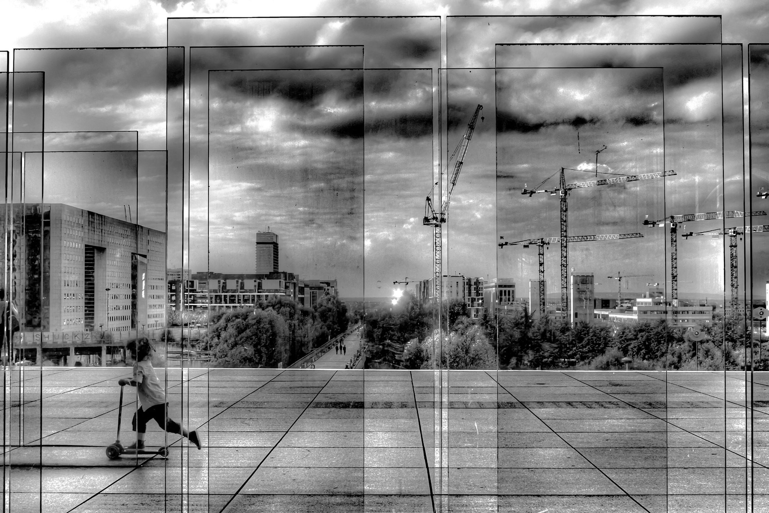 building exterior, architecture, built structure, city, men, glass - material, sky, person, illuminated, lifestyles, transparent, city life, cloud - sky, reflection, indoors, street, leisure activity, incidental people, walking