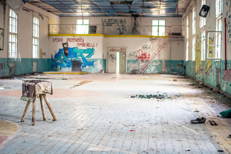 No People Architecture Built Structure Graffiti Indoors  Building Messy Abandoned Dirty Flooring Domestic Room Dirt Absence Window Day Creativity Industry Wall - Building Feature Damaged Art And Craft Architectural Column Ruined Tiled Floor