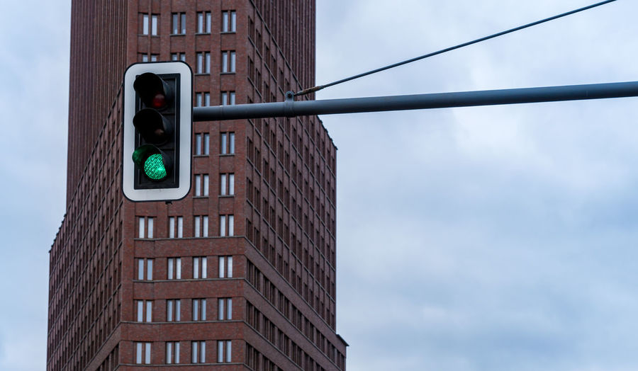 Berlin Photography Green Light Mobility In Mega Cities Traffic Transportation Architecture Building Exterior Built Structure City Close-up Day Green Light Mobility No People Outdoors Potsdamer Platz Sky Skycraper Stoplight Traffic Lights Colour Your Horizn