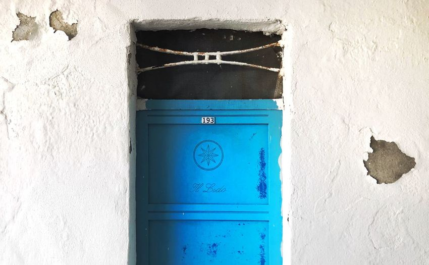 Close-up of blue door on building