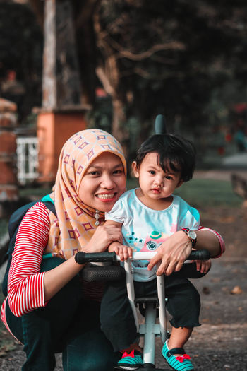 Portrait of smiling woman with daughter