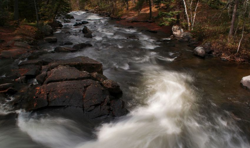 Beautiful Waterscapes Rushing River Provincial Park Autumn colors Warm Colors Water Rock Rock - Object Solid Motion Beauty In Nature Flowing Water Long Exposure Scenics - Nature Land Nature Forest River Flowing Tree Blurred Motion Environment No People Outdoors