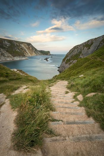 Cove Path | Man 'O War Cove, Dorset England Sea Nature Scenics Beach Tranquil Scene Beauty In Nature Water Sky Tranquility Grass Outdoors Horizon Over Water Sand Day No People Dorset Sea And Sky Seascape Cliffs Bay Cove Steps Lulworth Beach And Sky Sommergefühle Summer Exploratorium