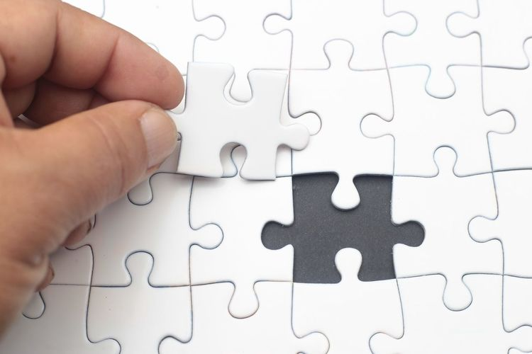 Cropped Hand Of Person Playing Puzzle