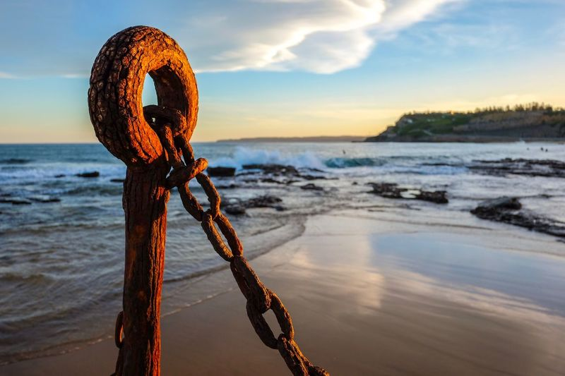 Sea & Rust Chain Rust Water Sky Sea Beach Land No People Sunset Nature Beauty In Nature Horizon Scenics - Nature Cloud - Sky Tranquil Scene Horizon Over Water Tranquility Rope Sand Orange Color Outdoors EyeEmNewHere