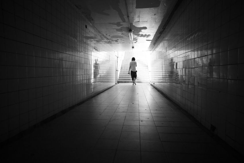 Walking the mile. #Contrast #moody #wideangle @blackandwhite @capetown One Person Real People Tunnel First Eyeem Photo