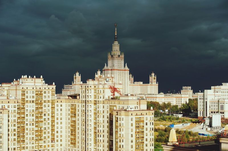 Lomonosov moscow state university and city against cloudy sky