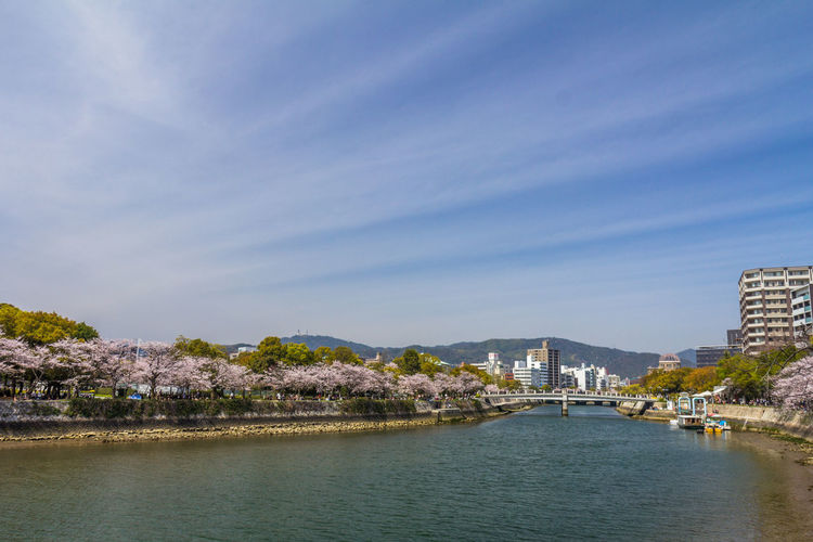 City of Hiroshima Hiroshima Hiroshima,japan Hiroshima -Miyajima Architecture Built Structure Building Exterior Water City Sky Nature Waterfront No People Building River Travel Destinations Day Tree Outdoors Cloud - Sky Scenics - Nature Connection Cityscape Bay