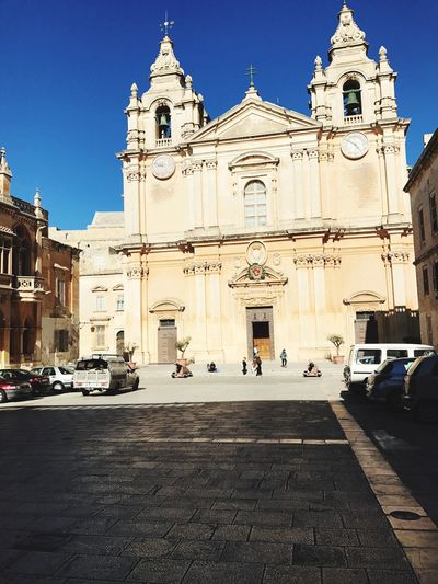 Mdina Cathedral Mdinacathedral Religion Place Of Worship Spirituality Architecture Built Structure Building Exterior Statue Outdoors Façade Day Low Angle View Sculpture Travel Destinations Sky Cross City Bell Tower No People