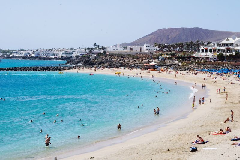 Been There. Beach Large Group Of People Sand Sea Vacations Enjoyment Water Building Exterior Outdoors Built Structure Real People Day Architecture Leisure Activity Clear Sky Summer Men Travel Destinations Lifestyles Nature Playa Blanca Lanzarote Fun Volcanic Island