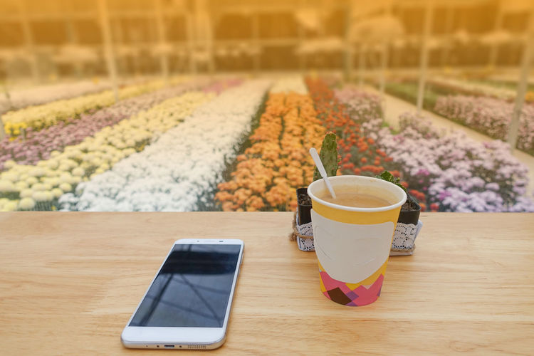Hot coffee Close-up Coffee - Drink Communication Day Drink Food Food And Drink Freshness Healthy Eating Indoors  Nature No People Portable Information Device Refreshment Table Technology Wireless Technology