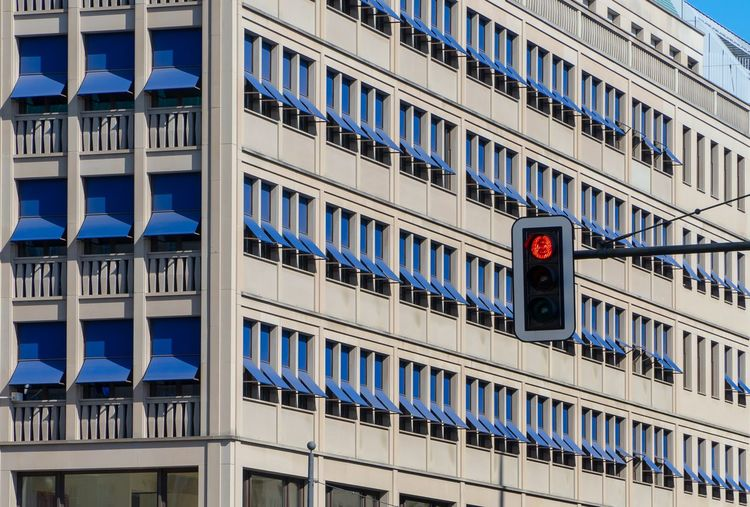 Traffic Light  Modern Architecture The Architect - 2018 EyeEm Awards Blue Sun Shades Sun Shades Architecture Built Structure Building Exterior Building Window City No People Modern Stoplight Sunlight Red Light Balcony Repetition In A Row
