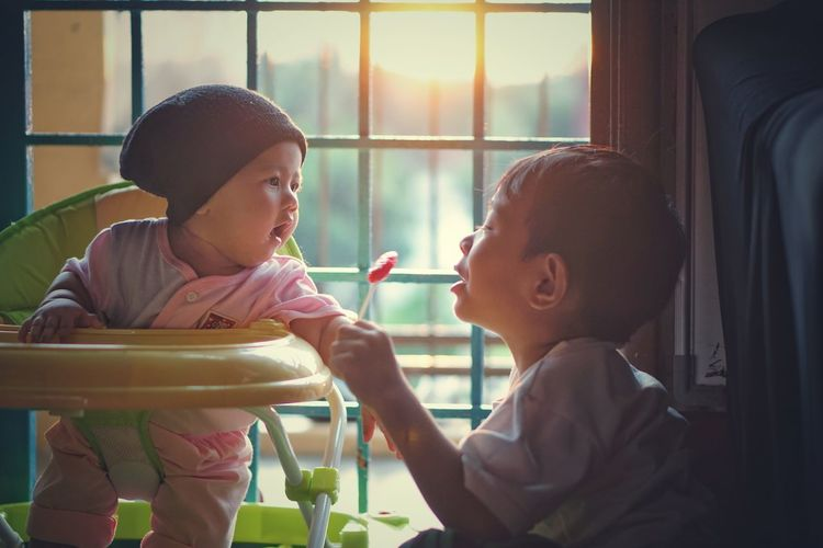 Window Indoors  People Child Happiness Smiling Day Cafe Eating Togetherness Lifestyles Enjoyment Cheerful Childhood Young Adult Bonding Felling Smile Love ♥ Baby Backlight Vintage Cute Soul Love Friendship
