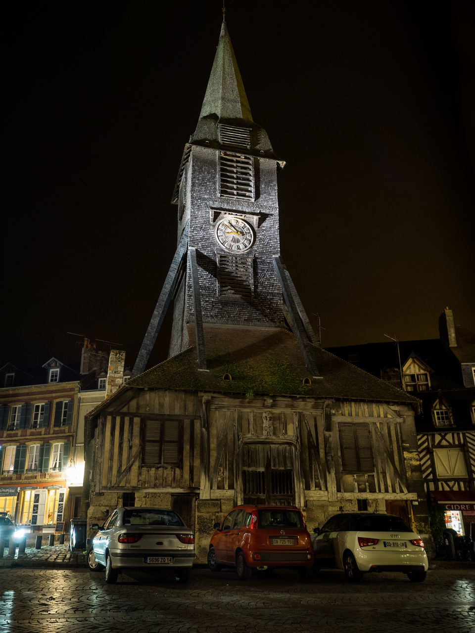 architecture, building exterior, night, built structure, car, religion, illuminated, spirituality, transportation, no people, place of worship, clock tower, mode of transport, history, travel destinations, outdoors, sky