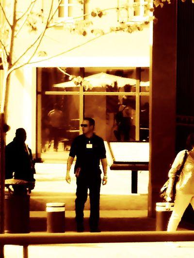 Rear view of man walking in illuminated restaurant