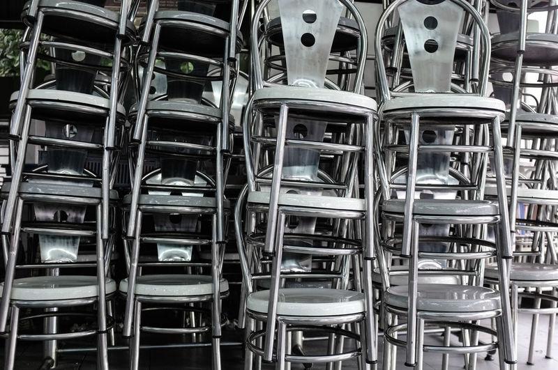 Stack of restaurant metal chairs during corona virus pandemic