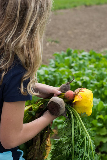 Bio Farmer Field Vitamins Young Blond Education Farm To Table Future Girl Healthy Diet Healthy Eating Organic Organic Farm Quality Control Red Beet Tour De Boer Vegetables Yellow Beets Young Adult