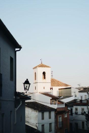 Church and buildings against sky