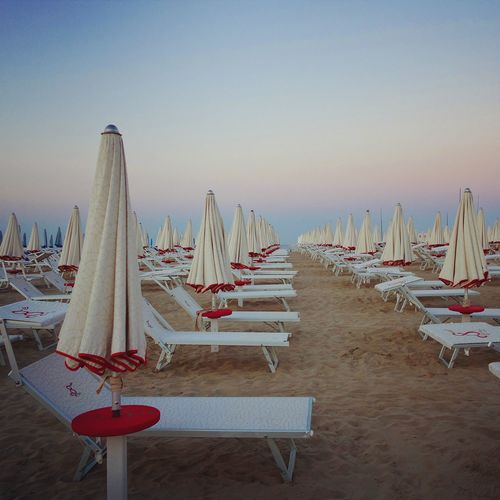Rimini beach Sunset Absence Arrangement Beach Blue Day Empty Group Of Objects In A Row Nature No People Outdoors Parasol Sky Sunset Tranquil Scene Tranquility