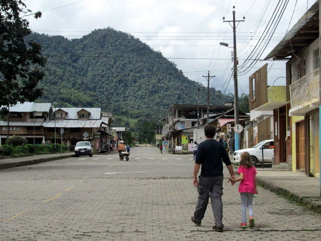 Cloud Forest Ecuador Enjoying Life Father And Daughter Full Length Leisure Activity Mindo Mountain Mountain Town On The Move Power Line  Rear View Road Small Town Travel Destinations Walking Around Town Walking Down The Street