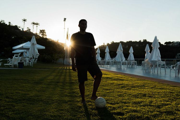 Man playing soccer at resort