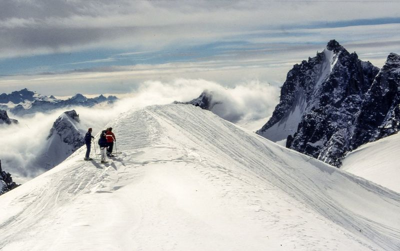 Rear view of mountaineers standing on snowcapped mountains