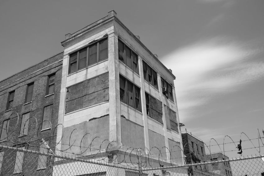 Riis Beach Abandoned Buildings Architecture Barbed Wire Blackandwhite Photography Broken Window Building Exterior Chainlink Fence Clouds And Sky Day Fence Fujifilm_xseries FujifilmX_US Lookingup No People Outdoors Photographyisthemuse Seagulls In Flight Sky