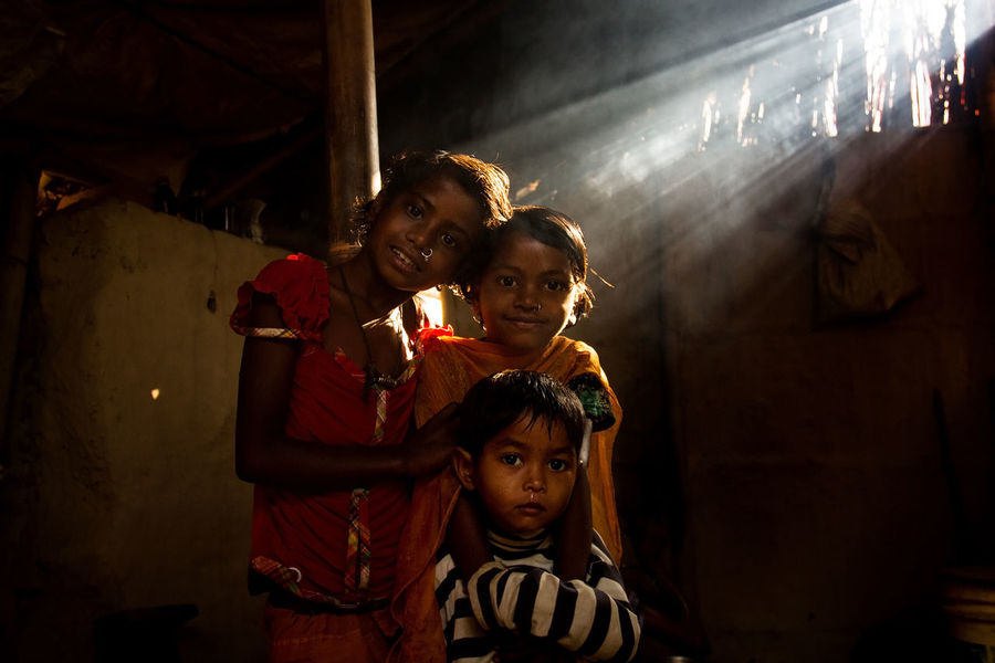 Three sisters looked at the Camera in the morning while morning sunlight lighten up their face. Adult Child Childhood Dark EyeEm EyeEm Best Shots EyeEm Gallery EyeEm Photo Of The Day EyeEmBestPics Indoors  Looking At Camera Males  Night People Portrait Rural Life Rural Lifestyle Rural Scene Siblings Smiling Son Standing Three Kid Togetherness Young Adult EyeEmNewHere EyeEmNewHere Women Around The World Women Around The World Connected By Travel