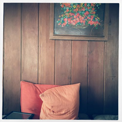 Pillows On Against Wooden Wall At Home