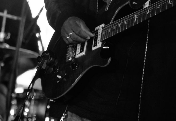 Cropped view of man playing guitar